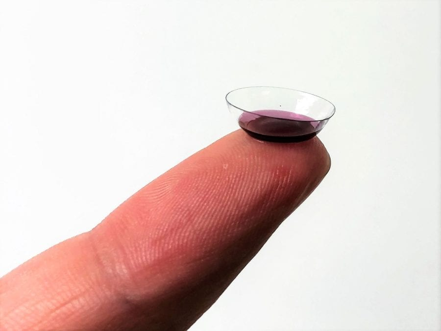 Migraine Contact Lens on Finger