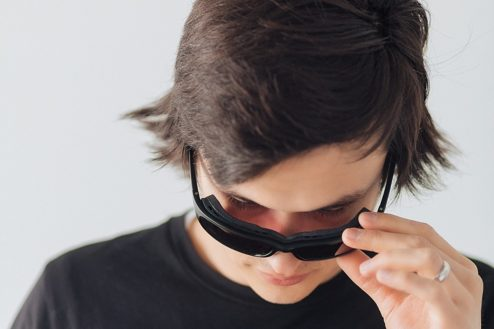 man showing off migraine sunglasses