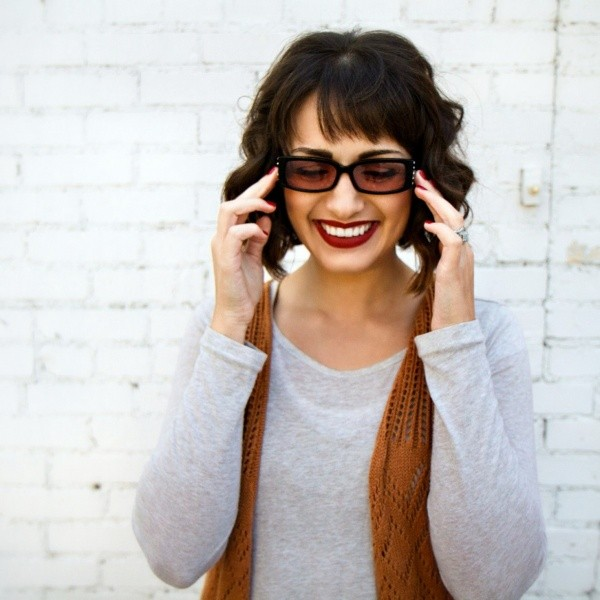 Women smiling wearing Art Deco Black photophobia glasses