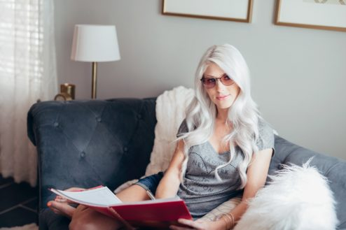 Girl wearing glasses with fl-41 tint on couch