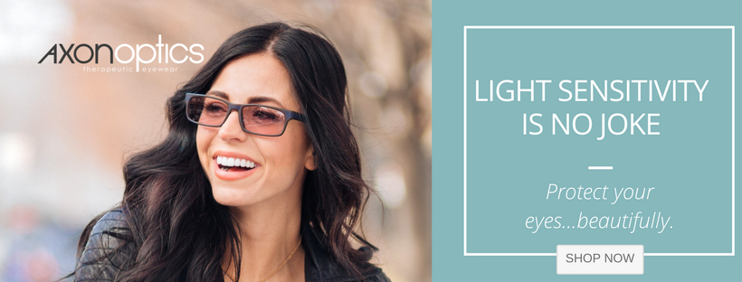 Girl wearing light sensitivity glasses