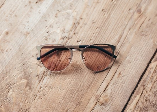 precision tinted lenses against wood