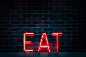 neon EAT sign for migraine diet