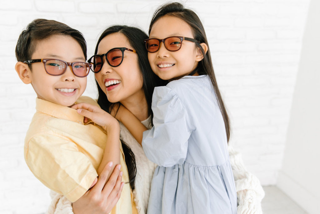 Mother and kids in Axon migraine glasses