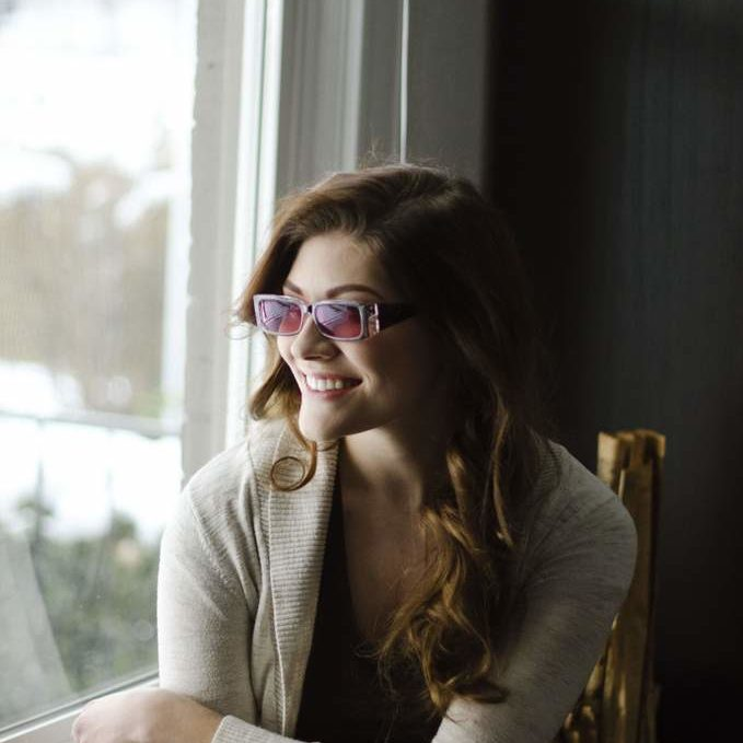 girl with light sensitivity glasses finding relief